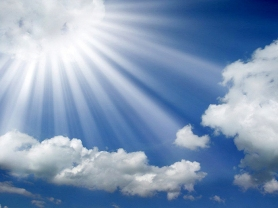 sun-rays-coming-out-of-the-clouds-in-a-blue-sky-wallpaper_edited-1